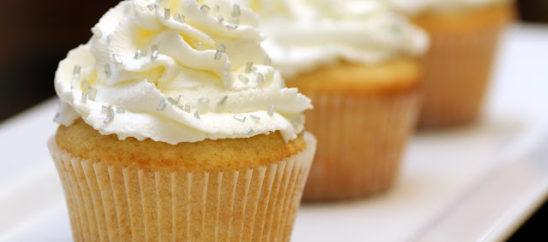Vanilla Cupcakes with Sweetened Whipped Cream Frosting