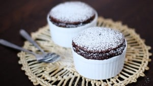 Chocolate soufflé with cream and cocoa-powder